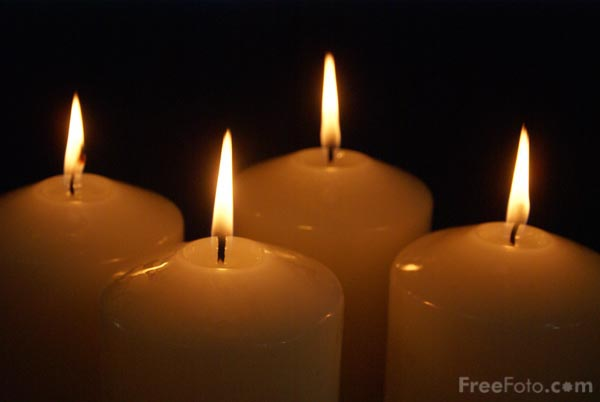 What do the candles in our Advent wreath mean  The